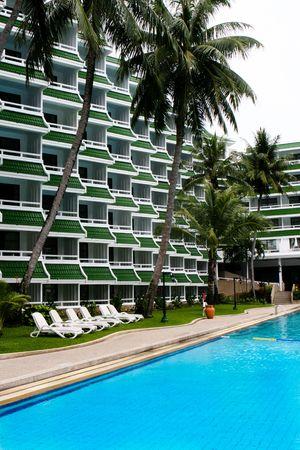Tropical resort buildings and swimming pool.\