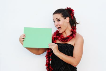 Beautiful woman holding a green board for text for Christmas. photo