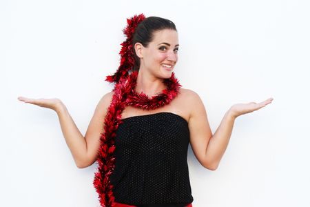 Beautiful young woman dressed in a festive Christmas outfit.