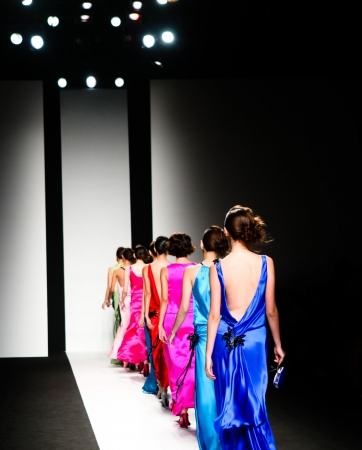 Models on the catwalk during a fashion show. photo