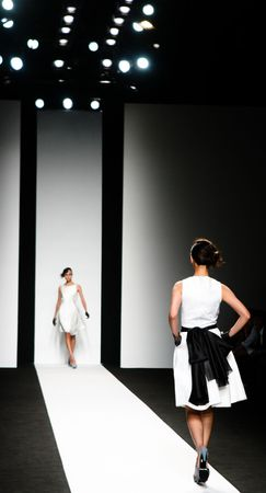 fashion catwalk: Models on the catwalk during a fashion show. Stock Photo