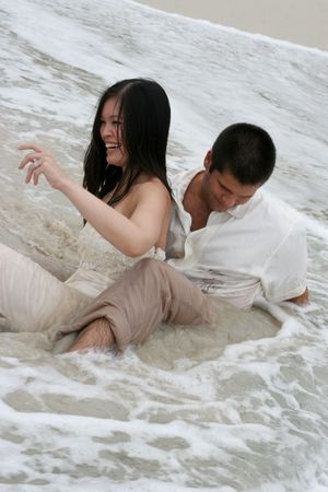passionate kissing: Bride and groom in the surf
