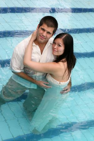 Romantic couple in the swimming pool. photo
