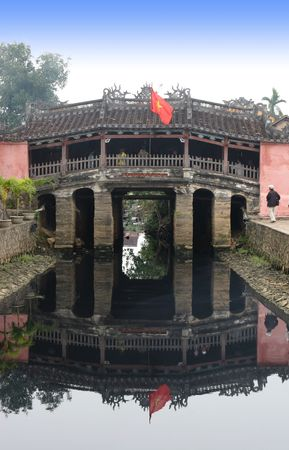 Bridge leading into the old town area of Hoi An in Vietnam - travel and tourism. photo