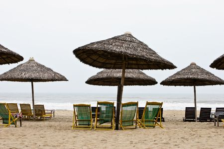 Deck chairs and umbrellas at the beach. photo