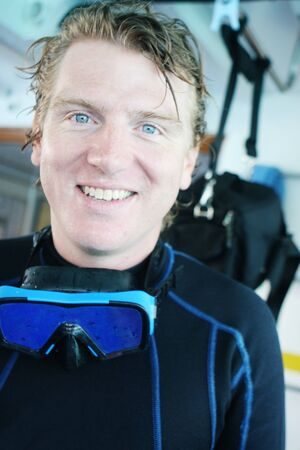 skindiver: Portrait of a happy blond scuba diver.