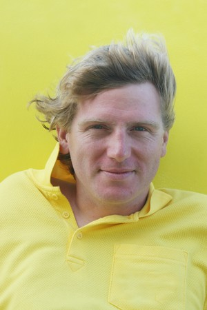 fair skinned: Happy blond man in a yellow shirt.