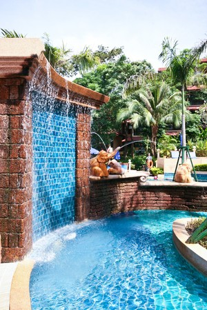 pool room: Elephant statues around a swimming pool at a tropical resort.