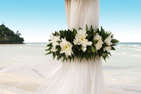 Floral arrangement at a wedding ceremony on the beach. photo