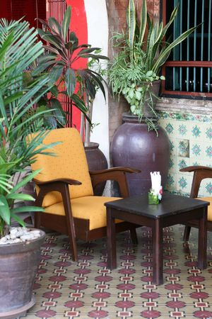 Table and chairs in the historical area of old Phuket town, Thailand - travel and tourism. 스톡 콘텐츠