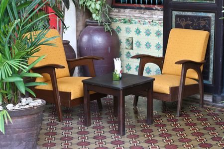 Table and chairs in the historical area of old Phuket town, Thailand - travel and tourism. photo