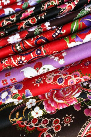 Rolls of fabric at a market in China town. photo