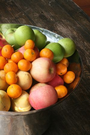 Bowl of fruit including oranges and apples. Stock Photo - 4077172