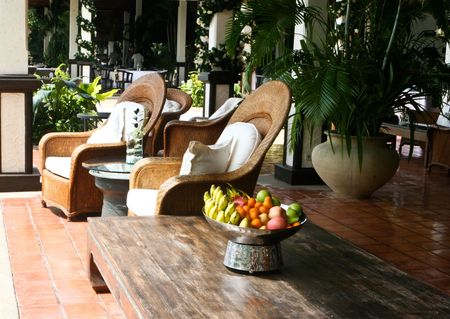 Cane and wooden furniture - home interiors. Stock Photo - 4077205