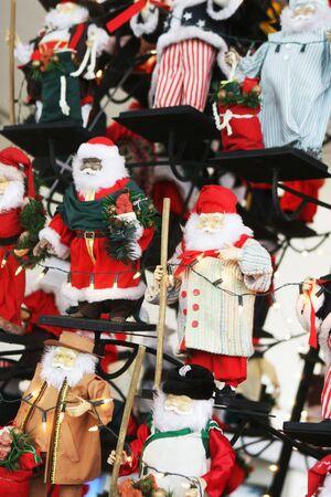 Santa decorations hanging on a tree. photo