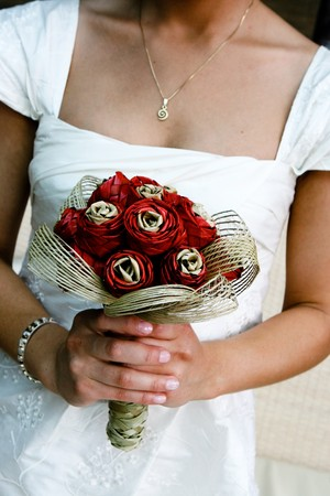 Close-up of a bride holding her wedding bouquet. photo