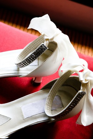 Bride's wedding shoes on a cushion. Stock Photo - 4121642