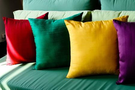 Colorful silk pillows on a sofa - home interiors.