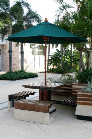 seating area: Table, chairs and umbrella - outdoor seating area.