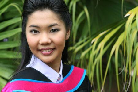 Asian university graduates celebrate success. Stock Photo - 4160167