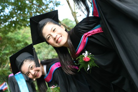 Asian university graduates celebrate success. Stock Photo