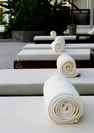 white towels: Fluffy white towels on deck chairs at a spa.