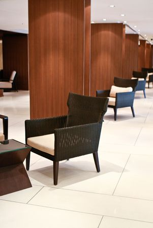 line lines luxury meeting: Interior of a modern hotel with table and chairs.