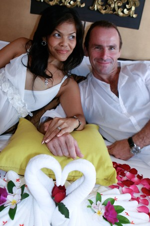 Honeymoon couple relaxing at a tropcial spa. photo
