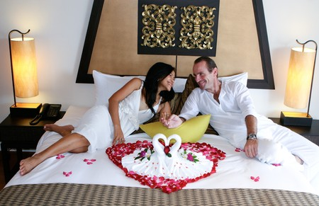Attractive multicultural couple in the honeymoon suite. photo