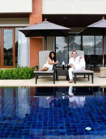 Happy couple by the pool. photo