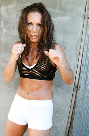 Attractive female working out during a training session. photo