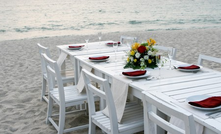 Elegant table setting at a wedding reception on the beach. Stock Photo