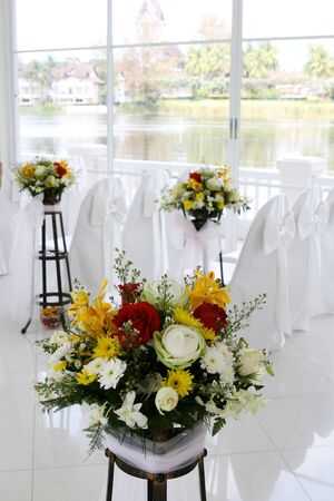 White wedding chapel decorated with beautiful flowers.