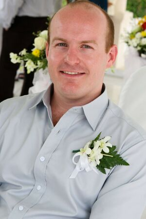 Happy groom in church on his wedding day. Stock Photo - 4445841
