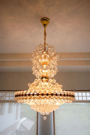 elaborate: Elaborate chandelier hanging from the roof - home interiors.