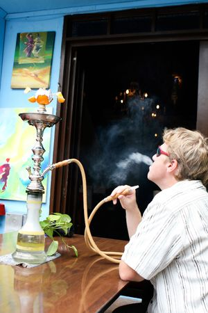 Man smoking a traditional Middle Eastern Hookah. photo
