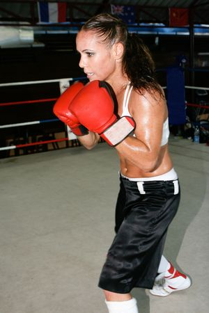 Female boxer at the gym working out. photo
