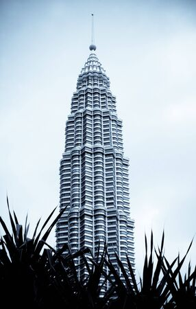Black and white image of a high rise tower in Kuala Lumpur, Malaysia - travel and tourism.