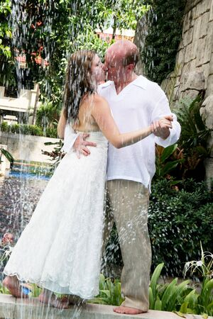 Gorgeous bride and groom dancing in the water during a trash the dress photo shoot. Stock Photo - 4665325
