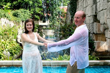 Bride and groom dancing in the water during a trash the dress photo shoot. Stock Photo - 4665329