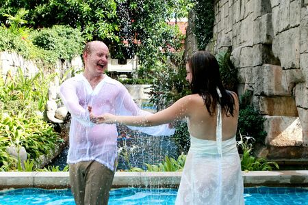 Gorgeous bride and groom dancing in the water during a trash the dress photo shoot. Stock Photo - 4665340
