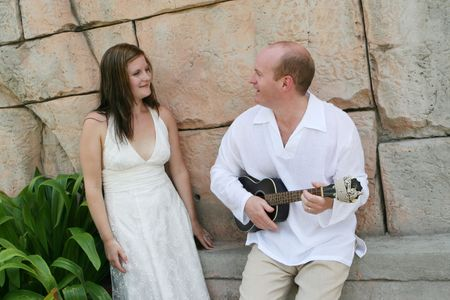 Groom playing the guitar to his new bride - black and white image. Stock Photo - 4665323