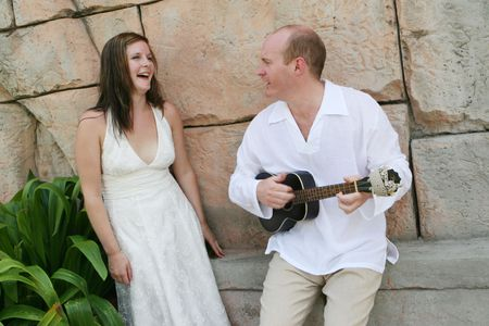 Groom playing the guitar to his new bride - black and white image. Stock Photo - 4665320