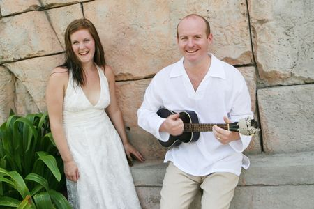 Groom playing the guitar to his new bride - black and white image. Stock Photo - 4665327