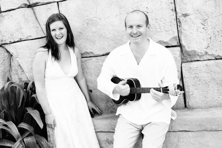 Groom playing the guitar to his new bride - black and white image. Stock Photo - 4665310