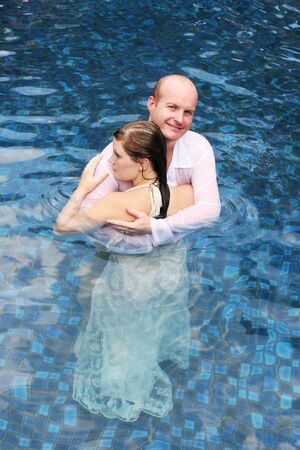 trash the dress: Gorgeous bride and groom in the water during a trash the dress photo shoot.