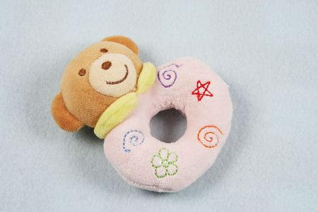 Cute baby rattle on a baby blanket.