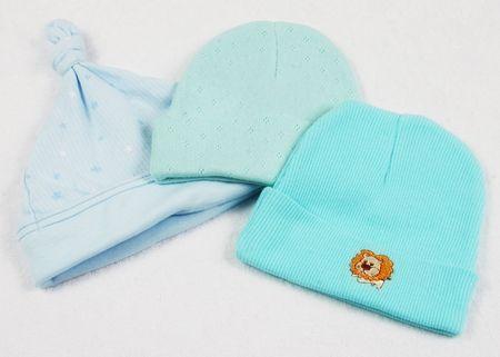 baby wardrobe: Cute baby hats on a baby blanket. Stock Photo