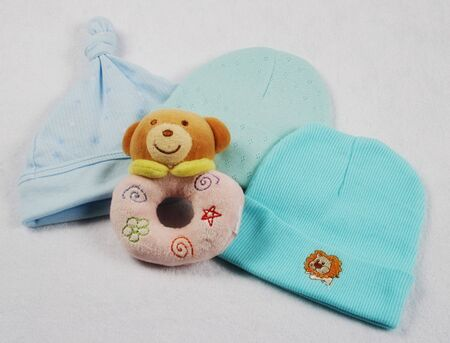 togs: Cute baby products on a baby blanket.