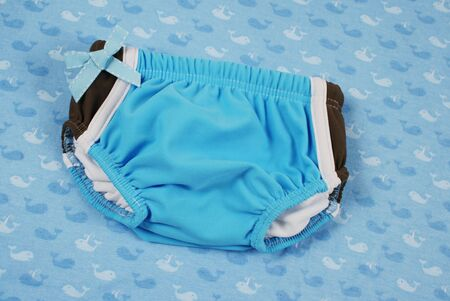 togs: Babys first swimsuit. Stock Photo